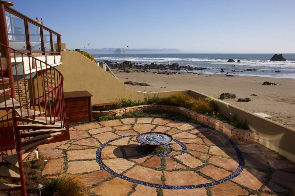 spiral-patio-beach-style-with-spiral-staircase-stacked-stone-fire-pit-8